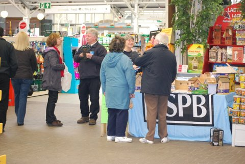 RSPB and custmers at the Bird box table