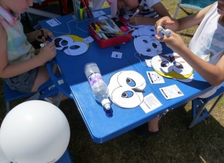 Colouring in wildlife masks at the Gravesend RSPB stall at the regatta